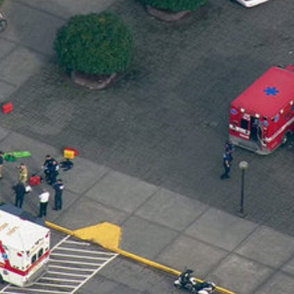 This image made from a video provided by KOMO shows emergency personnel responding after reports of a shooting at Marysville-Pilchuck High School in Marysville, Wash., Friday, Oct. 24, 2014.
