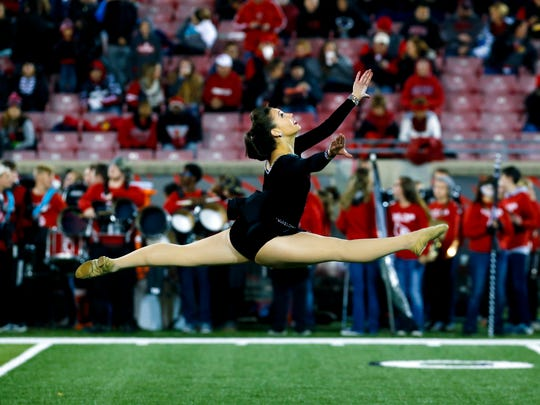 U of L's baton twirler Steffany Lien is from Nebraska and this is her first year on the squad. 'I'm used large crowds from competing at Worlds for baton twirling, but performing at Louisville football games are certainly different from any other experience.'Nov. 12, 2016