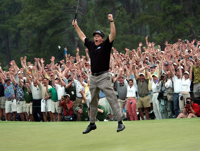 Phil Mickelson celebrates after winning the Masters golf tournament with at the Augusta National Golf Club in Augusta, Ga.