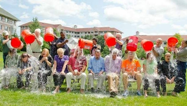 Members of the Seabrook Executive Team being drenched at the hands of some residents and other staffers.