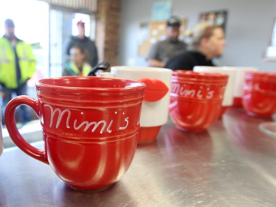 Souvenir coffee mugs are available at Mimi's Donuts