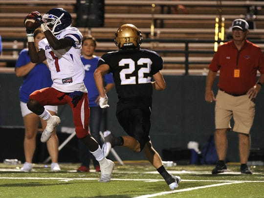Cooper receiver Myller Royals (1) catches a pass against Abilene High in 2016, a game won by the Eagles 55-38. Royals now is playing for Texas Tech.