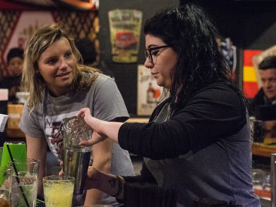Bartender Taylor-Marie Pierson mixes a drink at Roadie