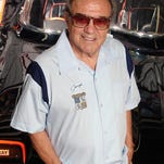 In this 2007 photo provided by Lozzi Media Services and Barris Kustom Industries, George Barris stands by the 1966 Batmobile that he designed at Barris Kustom Studios in North Hollywood. Barris, who created television's original Batmobile, along with scores of other beautifully customized, instantly recognizable vehicles that helped define California car culture, has died at age 89. Barris Kustom Industries spokesman Edward Lozzi says Barris died Thursday, Nov. 5, 2015, following a lengthy illness. (Lozzi Media Services/Barris Kustom Industries via AP)