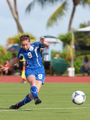 In this file photo, Guam's Paige Surber (9), center, finds the back of the net with the free kick during the East Asian Women's Football Championship preliminary round tournament game between Guam and CMNI at the LeoPalace Resort field.