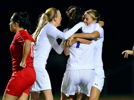 The Northern York girls' soccer team celebrates a goal