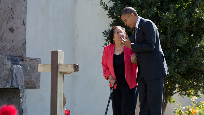 """President Obama, accompanied by Cesar Chavez' widow, Helen F. Chavez, places a special """"Cesar Chavez"""" red rose at the gravesite where Cesar E. Chavez was laid to rest in 1993, as he tours the Cesar E. Chavez National Monument Memorial Garden, Oct. 8, 2012, in Keene, Calif."""