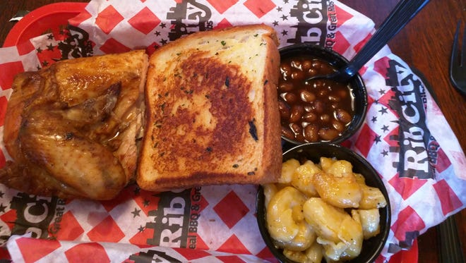 Rib City's chicken is brushed with sweet barbecue sauce and grilled to perfection. All entrees are served with garlic toast and choice of two sides including coleslaw, mac and cheese, French fries, corn on the cob, barbecue beans, baked potato, applesauce, green beans or sliced tomatoes.