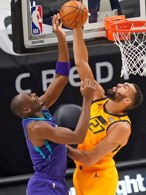Jazz center Rudy Gobert (27) blocks a shot by Charlotte's Bismack Biyombo during a February game. Gobert is second in the NBA with 2.7 blocks per game and is well on his way to a third Defensive Player of the Year award.
