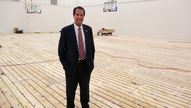 Drake University President David Maxwell tours the new practice facilities at the Knapp Center on Wednesday afternoon.