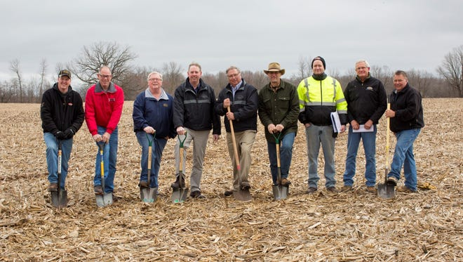 Representatives from Country Visions Cooperative and Kettle Lakes Cooperative, along with several of the contractors involved in constructing a new state-of-the-art agronomy facility in the industrial park in Plymouth broke ground at the site. Pictured, from left: Josh Schladweiler (Kettle Lakes Agronomy manager), Bill Parsons (Parsons Bros Construction), Mark Mentink (Kettle Lakes Cooperative general manager), Steve Zutz (Country Visions Cooperative CEO), Dennis Halbach (Country Visions Cooperative vice president of agronomy), Evan Nickodem (VIA Rail), Dan Tenpas and Mike Soerens (De Troye Electric), and Mike Brantmeier (Brantmeier Electric). A goal of completion in early 2018 puts this plant in operation before the spring planting season next year for the cooperative.
