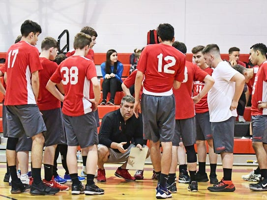 The Lakeland boys' volleyball team shifts their attention