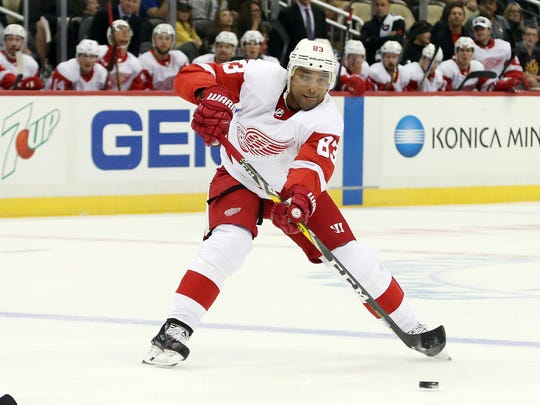 Sep 20, 2017; Pittsburgh, PA, USA; Red Wings defenseman Trevor Daley passes against the Penguins in the first period at the PPG PAINTS Arena.