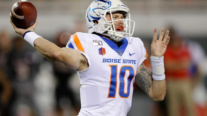 Boise State quarterback Chase Cord drops back for a pass against UNLV during the first half of an NCAA college football game Saturday, Oct. 5, 2019, in Las Vegas. (AP Photo/John Locher)
