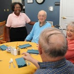 Joy Comstock chats with residents in the dining hall Wednesday at National Church Residences Chillicothe. Comstock was named Employee of the Year.