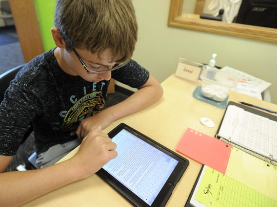 AJ Halvorson, 13, studies at Sylvan Learning Center. The program's director said more parents are bringing their students to help them go beyond what they are learning in school.