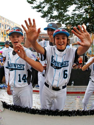 Bend North (Ore.) team members ride in the Little League Grand Slam Parade in downtown Williamsport, Pa.,  on Wednesday. Oregon faces Goodlettsville in their Series opener Thursday.