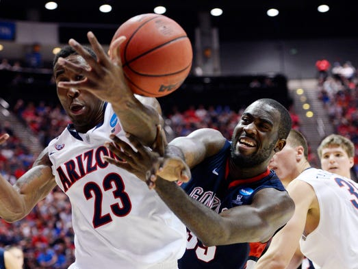Arizona Wildcats forward Rondae Hollis-Jefferson (23) battles for a loose ball with Gonzaga Bulldogs forward/center Sam Dower (right) during the first half of their third-round game.