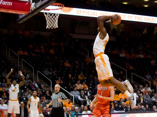 Tennessee forward Yves Pons (35) dunks the ball during Tennessee's basketball game against Mercer at Thompson-Boling Arena on Wednesday, Nov. 29, 2017.