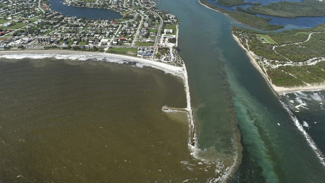 Dirty water filled with sediment and toxins in the Indian River Lagoon spews out from the Fort Pierce Inlet into the Atlantic Ocean Wednesday, Oct. 11, 2017, in Fort Pierce. Joe Negron, R-Stuart, said his 2018priority is making sure the South Florida Water Management District properly implements SB10, the 2017 bill he championed to secure state funding andset ambitious deadlines for a reservoir south of the lake which is expected to drastically improve water quality.