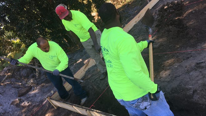 From left: David Ortiz, Johnny B. Smith and Wayne Blanks of Tobler Construction work on the beginnings of a home foundation Thursday in Fort Myers.