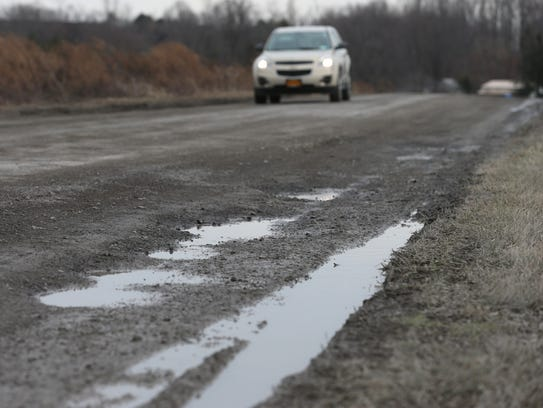 Chili residents battle town over repairs on bumpy Milewood Road