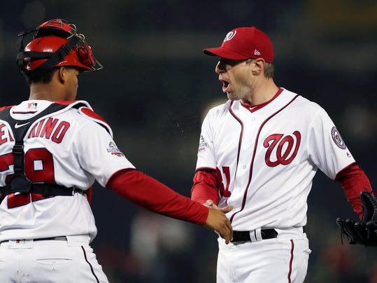 Washington Nationals starting pitcher Max Scherzer (31) celebrates the final out with catcher Pedro Severino at the end of a baseball game against the Atlanta Braves at Nationals Park, Monday, April 9, 2018 in Washington. Nationals won 2-0. (AP Photo/Pablo Martinez Monsivais)