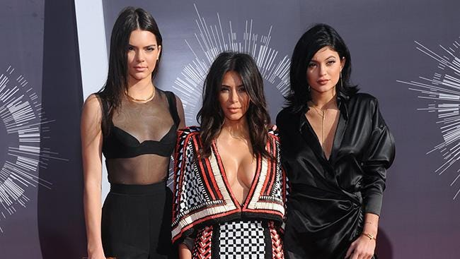 Kim with Kendall and Kylie.