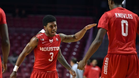 Houston Cougars guard Ronnie Johnson (3) reacts after