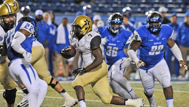 "Vanderbilt Commodores running back Ralph Webb (7) rushes to score the winning touchdown against the Middle Tennessee Blue Raiders during the second half at Johnny ""Red"" Floyd Stadium on Oct. 3, 2015. Vanderbilt won 17-13."