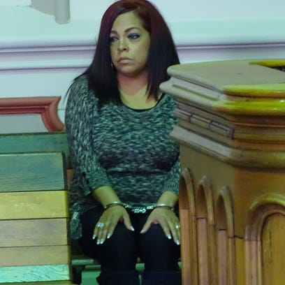 Patricia L Thomas sits in handcuffs after Judge Mark