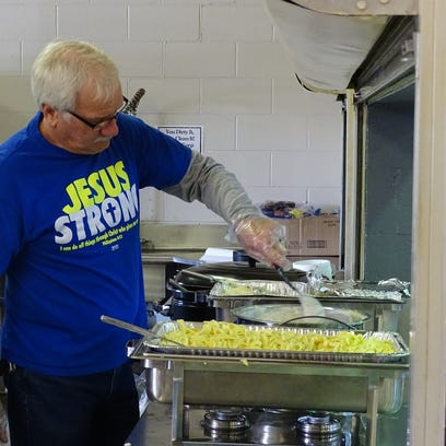 Gary Jordan stirs some food Thursday afternoon in the