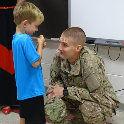Sgt. Jake Thomas (right) greets his nephew Aiden McCloy