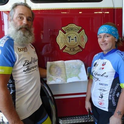 Bob Quick and daughter Jillian Quick show a map of