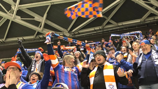 FC Cincinnati fans react with cheers, disbelief and for some, tears at the team's first goal in Major League Soccer.