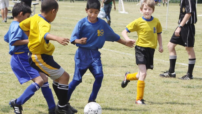 Kids face off for a Saturday of games at Heritage Park in Clarksville, where the Montgomery County Soccer Association holds weekly competitions.