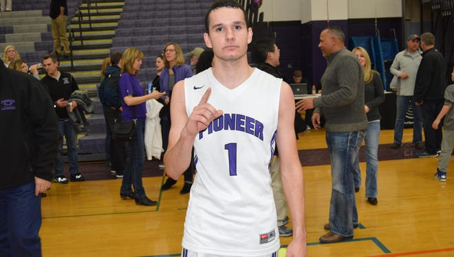 Pioneer senior guard T.J. Roberts hit four free throws in final minute to seal the 70-66 win over Huron.