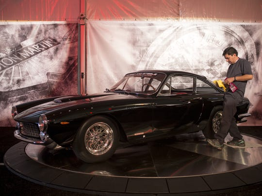 Rayes Baras wipes down at 1963 Ferrari 250 GT Lusso,