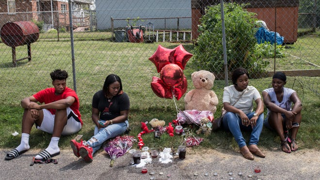"""Friends and family of Tyson Gibbs, the 19-year-old shooting victim that was killed Saturday evening just off of 38th Street's 400 block, sit near his memorial at the crime scene. """"It hurts,"""" Gibbs brother Malik, pictured at far left, said. """"The violence isn't going to stop. There's no stopping it."""" July 17, 2017"""