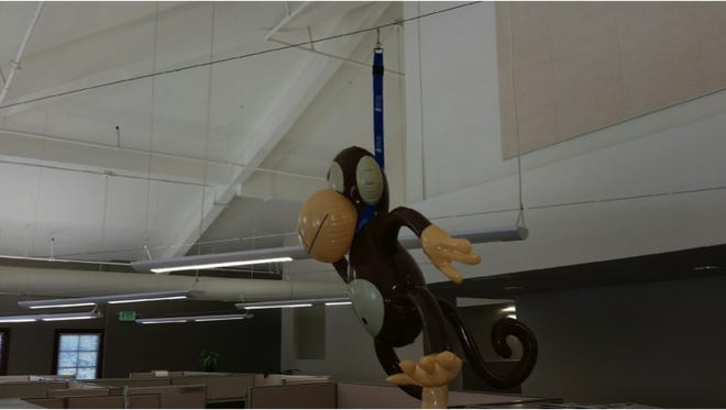 LULAC officials said they received complaints regarding a monkey doll hanging over a work cubicle at the Gold Coast Health Plan.