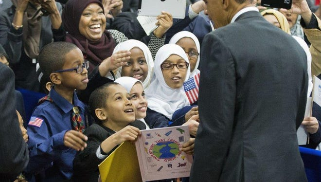 President Barack Obama stops to greets children from Al-Rahmah school and other guests during his visit to the Islamic Society of Baltimore, Wednesday, Feb. 3, 2016, in Baltimore, Md. Obama is making his first visit to a U.S. mosque at a time Muslim-Americans say they're confronting increasing levels of bias in speech and deeds