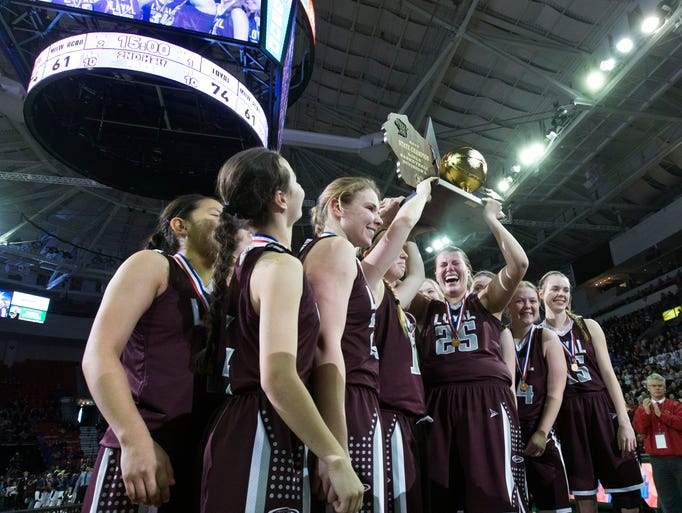 Loyal hoists their championship trophy after their