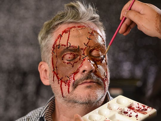Fake blood is applied with a paintbrush to pockets