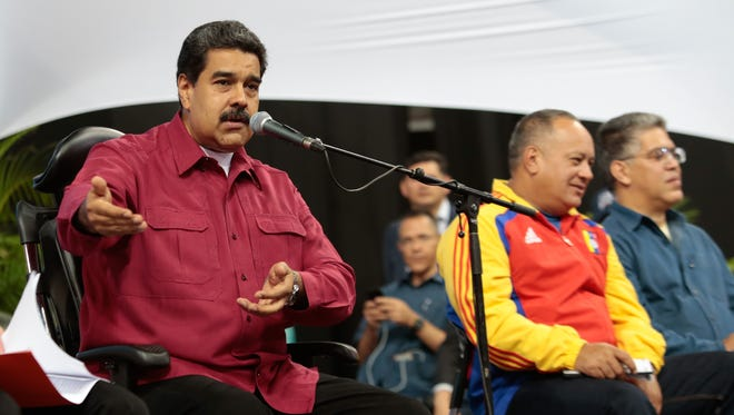 Venezuelan President Nicolas Maduro talks during a meeting with constitutionalists in Caracas on Wednesday.