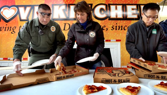 Smyrna Mayor Mary Esther Reed, center, helps serve pizza at the Smyrna Boys & Girls Club of Rutherford County on Dec. 3, 2014. Reed is running unopposed in the Nov. 6 election.