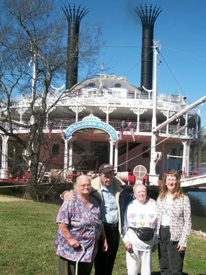 Stewart County Senior Citizen Center folks, from left, Wanda Garsia,  Bob Dolan, Wanda Green and Becky Hayslip take time to see the American Queen Steamboat when it docked in Dover recently.