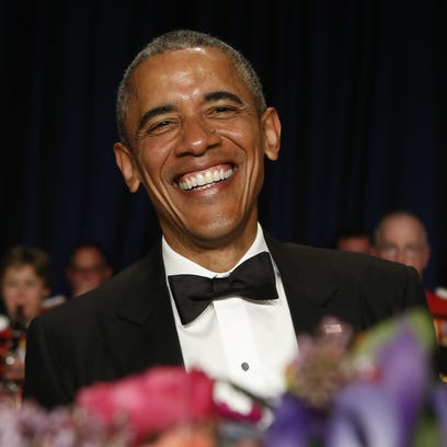 Present Obama laughs at the 2015 White House Correspondents'