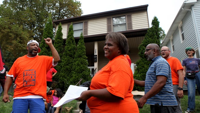 MAX SCHULTE/@maxrocphoto/ STAFF PHOTOGRAPHER Elizabeth McGriff and supporters from the housing rights group Take Back the Land hold an anti-eviction rally at McGriff?s home on Cedarwood Terrace. McGriff has been trying to work out a solution with her mortgage lender but is in danger of losing her home. Elizabeth McGriff  and supporters from Take Back the Land held an anti-eviction rally at  McGriff's home on at Ceaderwood Terrace. McGriff has been trying to work out a solution with her mortgage lender but is in danger of lousing her home.
