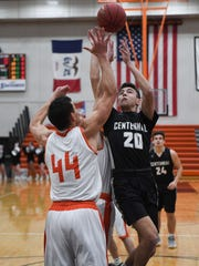 Valley's Quinton Curry (44) defends as Ankeny Centennial's