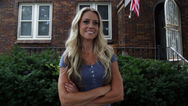 Nicole Curtis of Rehab Addict on the DIY Network in front of a Detroit home on Tuesday, July 23, 2013, that she is rehabbed for her show.